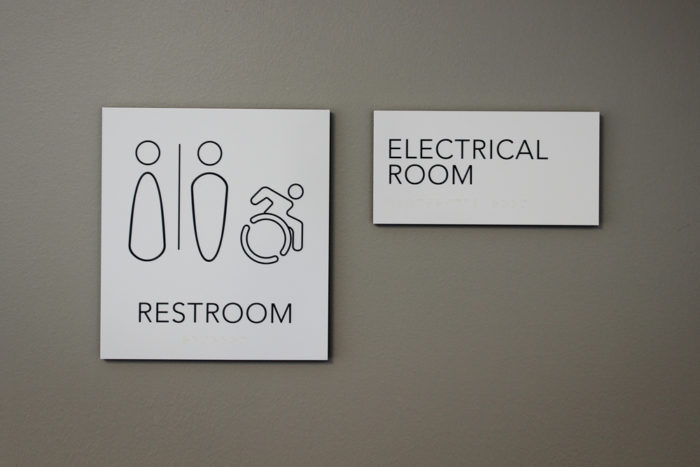 Restroom and room identification signs with raised copy and clear braille for the visually impaired.